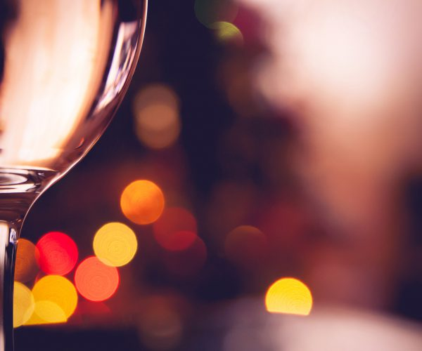 Glasses of wine close-up. Bokeh and coloured background. Festive atmosphere.